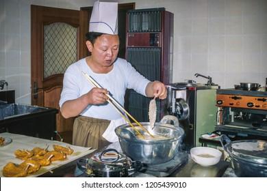 An extremely rare photo of Kim Jong Il.... cooking, Pyongyang, North Korea, May 22, 2018