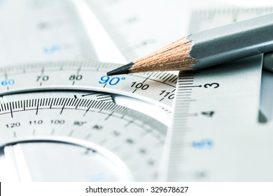 extremely selective focus a part of the silver pencil and precision measurement tool , concept of construction or building design drawing idea