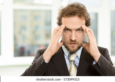 Extremely tired. Mature bearded businessman in a suit looking tired and exhausted rubbing his face copyspace stress depression exhausted failure boring crisis deadline frustration pressure concept