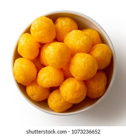 Extruded puffed cheese balls in white ceramic dish isolated on white from above.