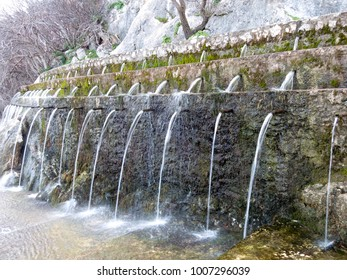 The exuberant water source that gives life to this work of man attached to the rock,The Fuente de los Cien Caños [Fountain of a Hundred Pipes], a natural site in Villanueva del Trabuco, Spain