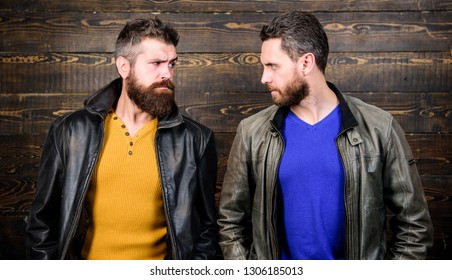 Exude masculinity. Men brutal bearded hipster. Confident competitors strict glance. Masculinity concept. Masculinity attributes. Brutality confidence and masculinity interconnection. True man temper.