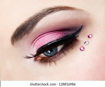 Eye close up with beautiful make-up, macro photography