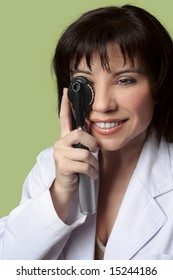 An eye doctor optometrist using ophthalmoscope.