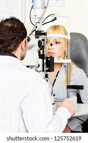 Eye doctor performing an eye examination