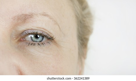 the eye of an elderly woman with wrinkles