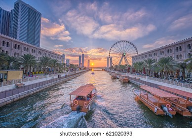 Eye of the Emirates - ferris wheel in Al Qasba - Shajah at sunset