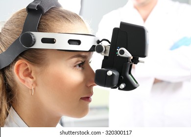 An eye exam at an ophthalmologist, ophthalmoscope.Ophthalmologist examines the eyes using a ophthalmic device