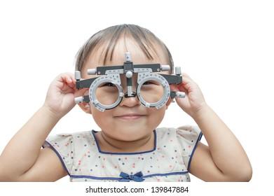 Eye examination and refraction, child.