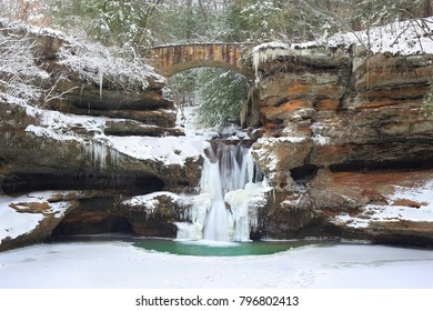 An eye- level view of Old Man's Cave Upper Falls at Hocking Hills State Park, Ohio in  winter.