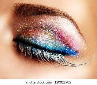 Eye Makeup. Beautiful Eyes Glitter Make-up. Holiday Makeup detail. False Lashes