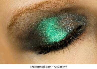Eye makeup with green shadows