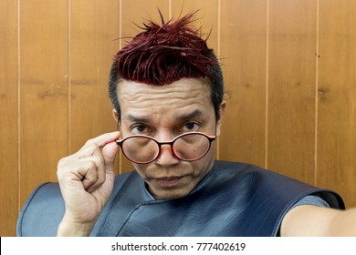 The eye of man in Asia. Asian guy handsome auburn hair dyed a camera.Man wearing glasses hair dyed a camera.