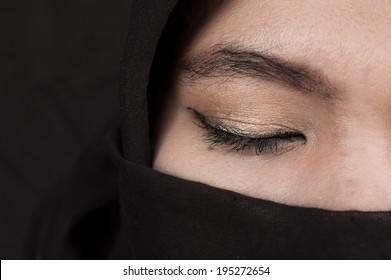 eye of  Muslim woman on black background