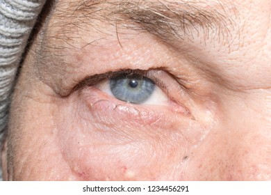 Eye of old man eyelashes pupil for design