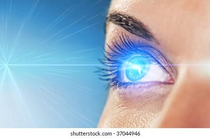 Eye on blue background (shallow DoF)