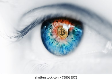 Eye of a person with the bitcoin coin logo in the pupil