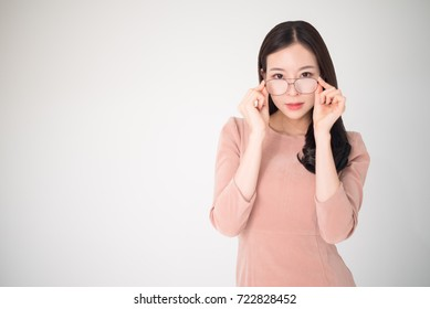 Eye problems concept such as near-sighted, myopia, far-sighted, astigmatism, cataract, glaucoma, ophthalmology, optometry. Asian woman holding eyeglasses fashion isolated on white background