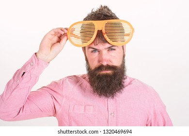 Eye protection sunglasses accessory concept. Sunglasses party attribute and stylish accessory. Hipster wear shutter shades extremely big sunglasses. Man bearded guy wear giant louvered sunglasses.