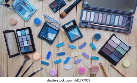 Eye shadow and brush on wooden background, Make up, Cosmetic background