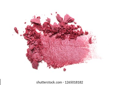 Eye shadow on a white background. Scattered blush sample for makeup. Red color