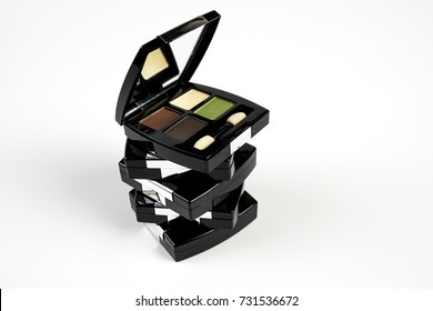 eye shadow palette in brown, white, dark brown and green color on white background./ eye shadow palette.