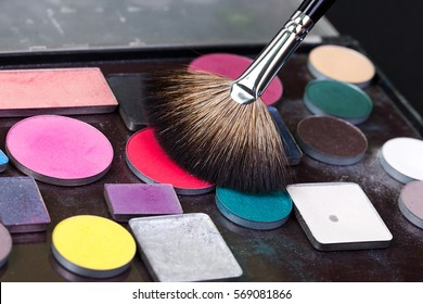 Eye shadow palette in natural colors and makeup brushes
