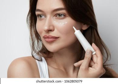Eye Skin Care. Beautiful Woman Applying Eye Cream On Skin Under Eyes. High Quality