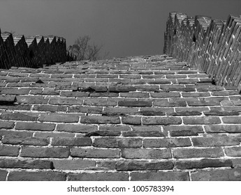 Worm's eye view of steep steps on the ruins of the Great Wall of China near Beijing