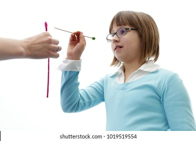 Eye vision therapy. Young girl at optometrist clinic