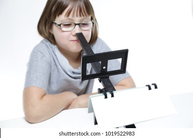 Eye vision therapy. Young girl with aperture rule