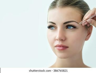 Eyebrow correction. Eye brow correction procedure for the model with long eyelashes