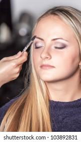 Eyebrow shaping in professional studio.