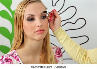Eyebrow shaping in professional studio