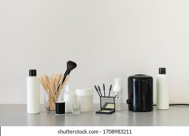 Eyebrow treatment products including hair removal tools, tinting applicators and brow tailoring makeup goods.  Set up against a plain white background in a neutral colour palette