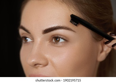 Eyebrows correction. Shape. Beautiful young woman with perfect natural eyebrows and eyelashes.