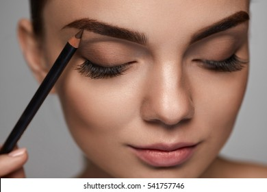 Eyebrows Makeup. Beautiful Woman With Closed Eyes, Perfect Make-up Contouring Brows With Brown Eyebrow Pencil. Closeup Of Female Model Beauty Face With Smooth Skin On Grey Blackground. High Resolution