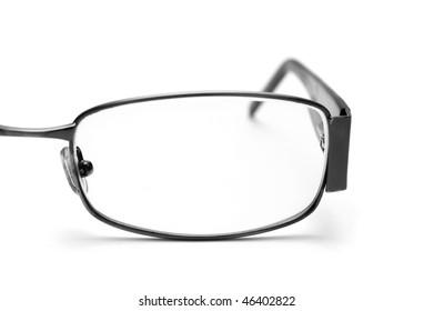 Eyeglass closeup on white background