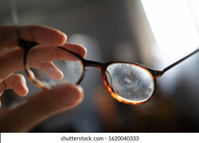 Eyeglasses with dirty marks on lens