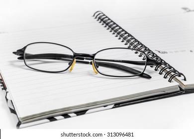 eyeglasses on a blank paper
