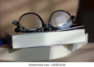 eyeglasses on pocket book with morning light