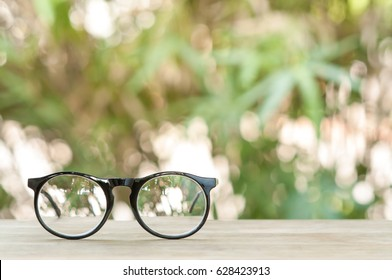 Eyeglasses on wooden table.