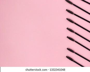 Eyelash brushes concept, mascara on pink background