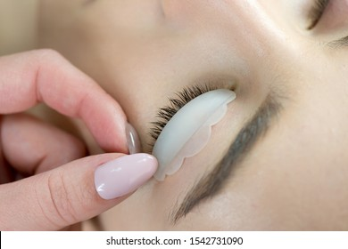 Eyelash Care Treatment: eyelash lifting, staining, curling, laminating and extension for lashes.  Close up of beauty model's face with perfect fresh skin and long eyelashes, lash lift laminate.