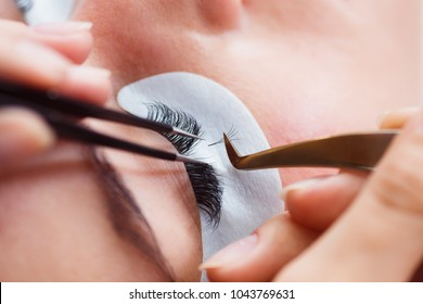 Eyelash Care Treatment Procedures: Staining; Curling; Laminating and Extension for Lashes. Beauty Model with Perfect Fresh Skin and Long Eyelashes. Skincare; Spa and Wellness. Close up.