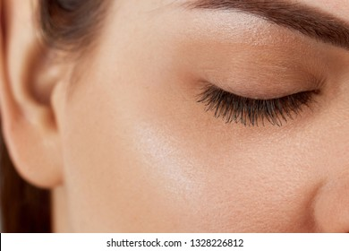 Eyelash Care Treatment Procedures: Staining; Curling; Laminating and Extension for Lashes. Beauty Model with Perfect Fresh Skin and Long Eyelashes. Skincare; Spa and Wellness. Close up.Cosmetics