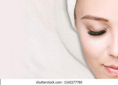 Eyelash Extension Procedure. Woman with Clean Fresh Skin. Beautiful young girl in a beauty salon. Cosmetology, beauty, skincare and spa Concept. Permanent Makeup. Microblading brow. Facial treatment.
