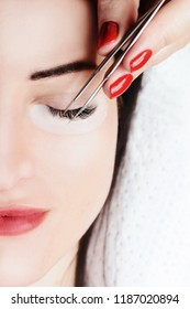 Eyelash Extension Procedure. Woman Eye with Long Eyelashes. Lashes, close up, macro, selective focus