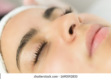 Eyelash treatment applied to a young woman
