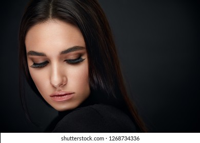 Eyelashes Makeup. Woman Beauty Face With Black Lashes Extensions